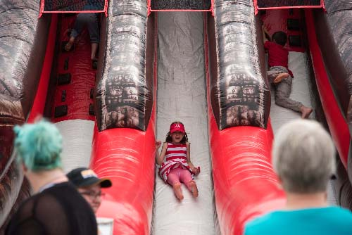 Children on inflatable slides at the FunFest