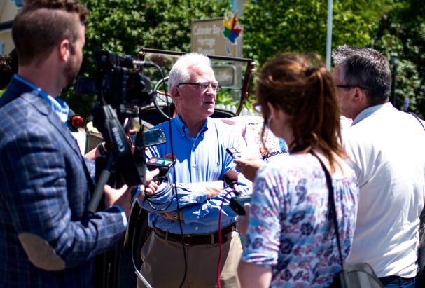 John Butte being interviewed by reporters