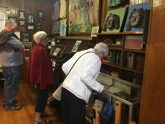 a guest looks at the doctor Allan Roy Dafoe display case