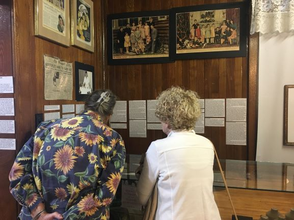 Two guests read educational panels on the Dionne quintuplets in the museum