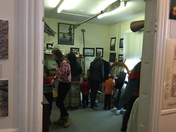 Families look in the shipping room for a hidden easter egg