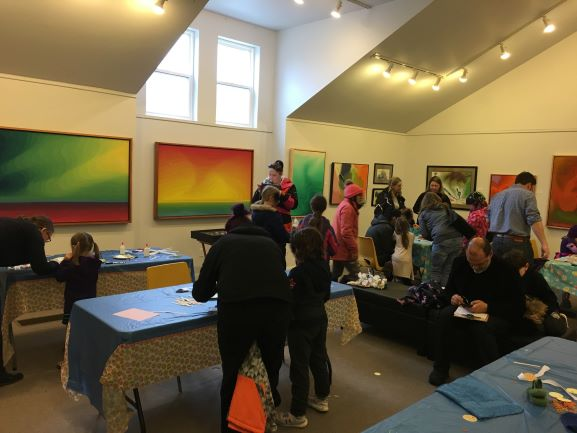 Families make easter crafts in the art gallery