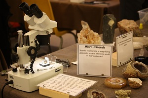 rocks and a microscope on a table